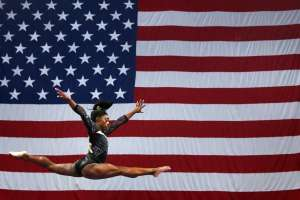 "Simone Biles, ""The Three-Time World All-Around Champion (2013–15), Three-Time World Floor Champion (2013–15), Two-Time World Balance Beam Champion (2014, 2015), Four-Time United States National All-Around Champion (2013–16), And A Member Of The Gold Medal-Winning American Teams At The 2014 And 2015 World Artistic Gymnastics Championships"", Takes Commanding Lead On Day 1 Of The USAG Championships"