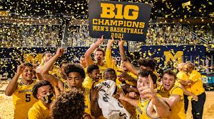 THE UNIVERSITY OF MICHIGAN BASKETBALL TEAM SCORES A GREAT SEASON WITH JUWAN HOWARD AS THEIR GREAT COACH